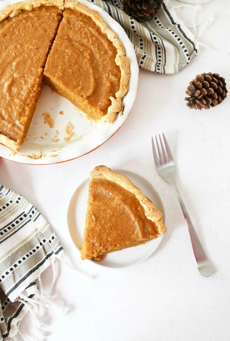 Sweet Potato Pie on a white table with a fork.