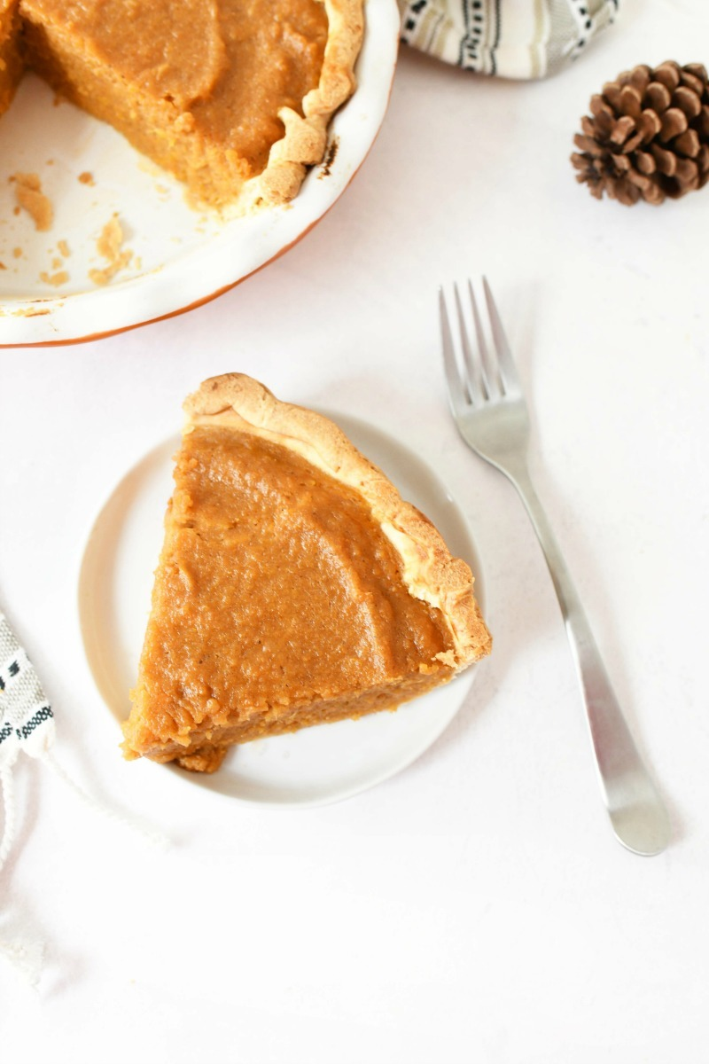 Sweet Potato Pie Slice with a fork on a white table.