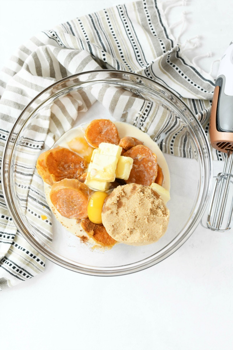 Sweet Potato Pie filling ingredients in a glass dish.