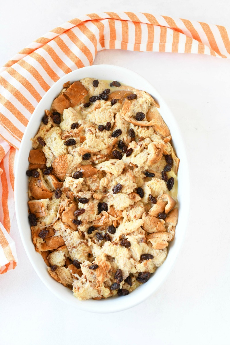 Unbaked french toast bake in a white casserole dish.