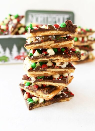 Christmas Toffee Candy stacked on top of each other on a white table.