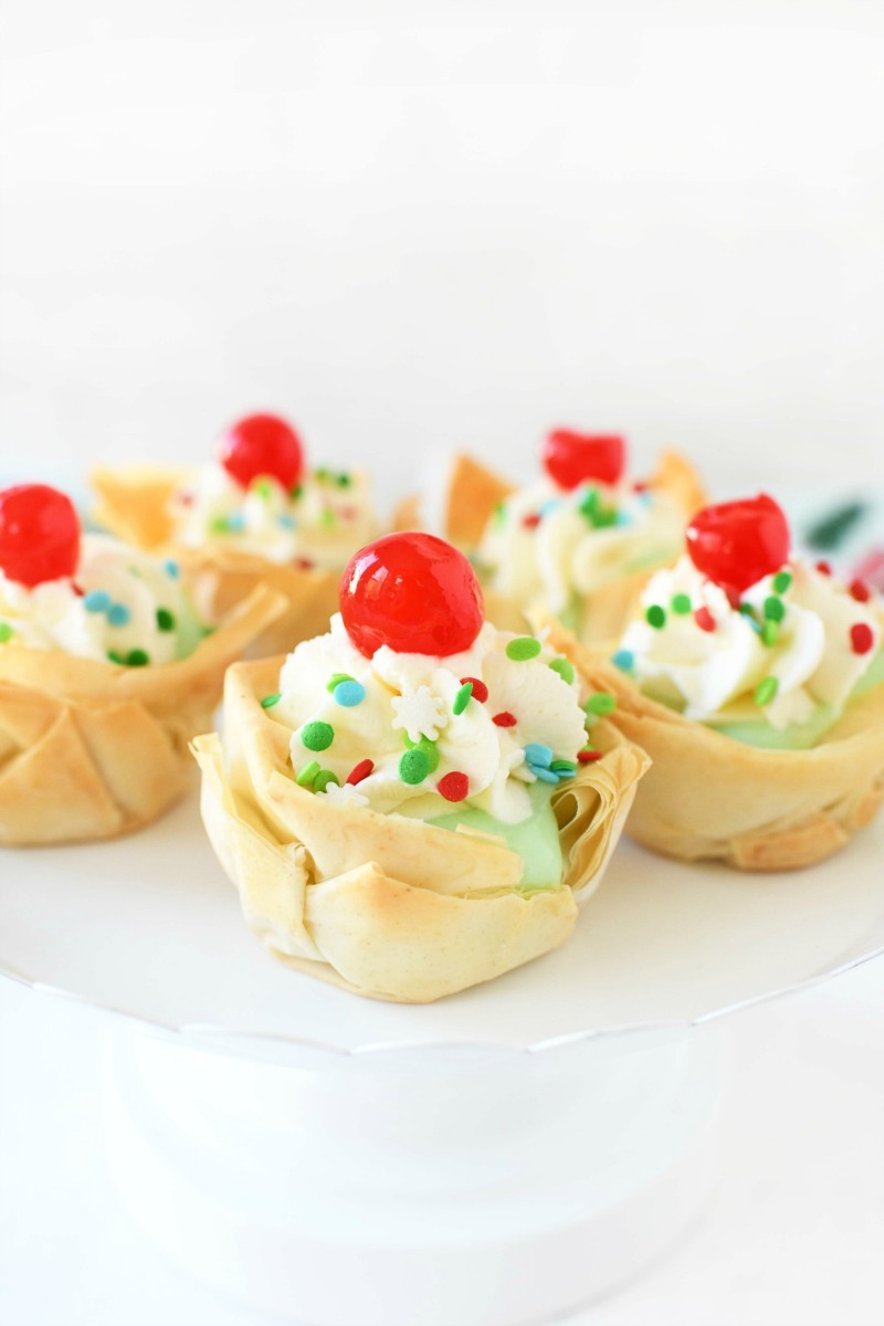 Phyllo Dough with pistachio pudding min dessert cups with pudding, cherry, and sprinkles.