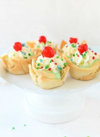 Pistachio Phyllo Dough Cups on a white cake stand.