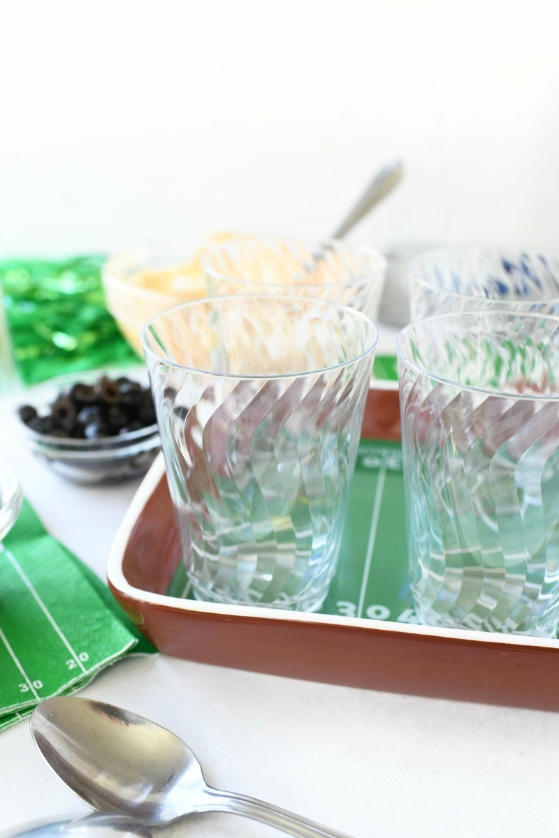 10 ounce clear cups on a football tray.