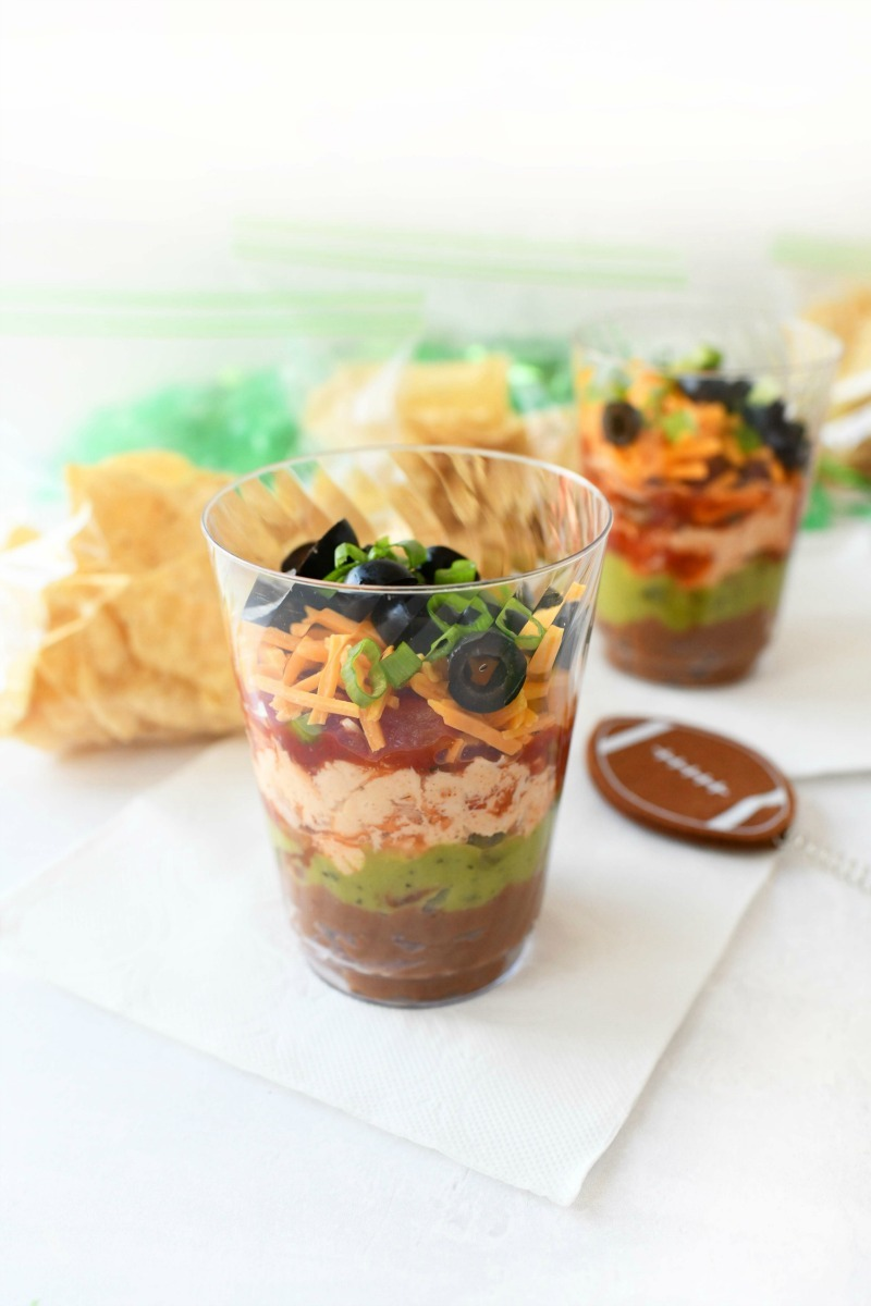 7-Layer dip cup serving on a Vanity Fair white napkin.