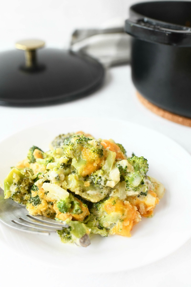 Cheesy Broccoli Casserole on a white plate.