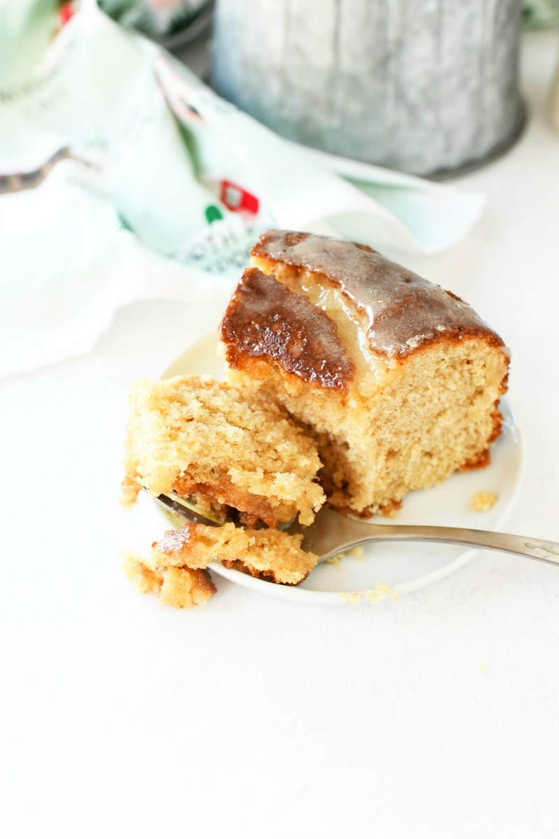 Eggnog Moist Bundt Cake with a fork taking a bite out of it.