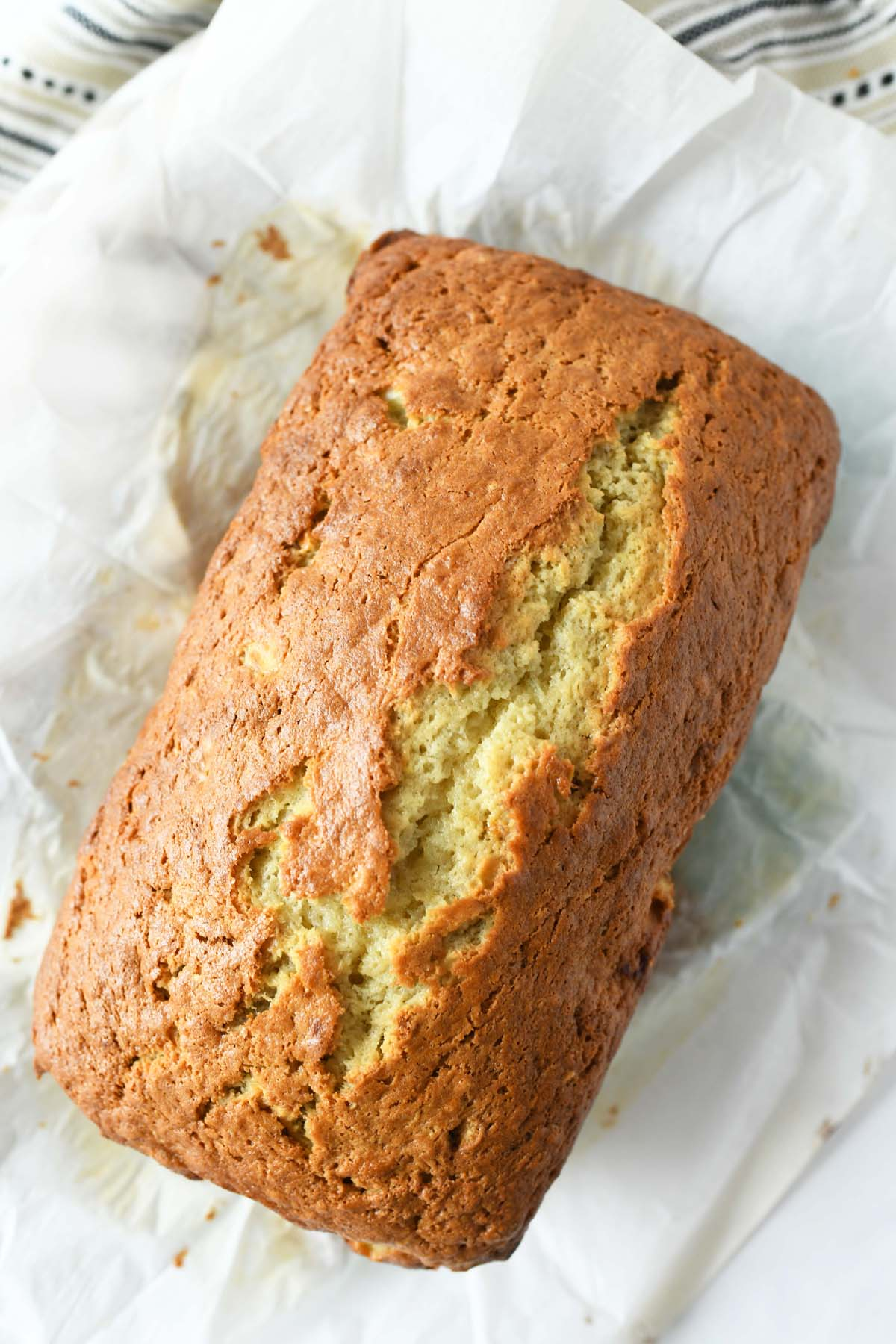 Banana Bread with Sour Cream on a piece of white parchment paper.