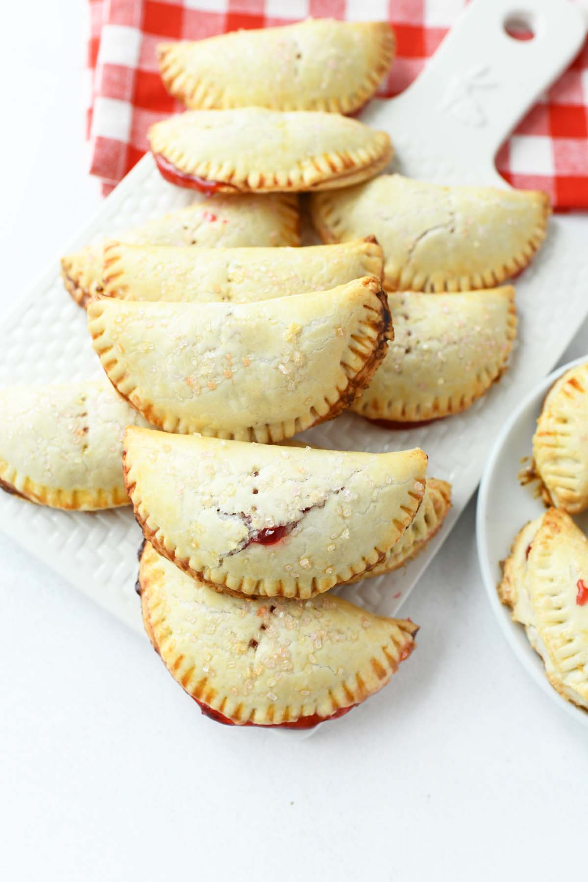 Cherry Hand Pies stacked together on a table.