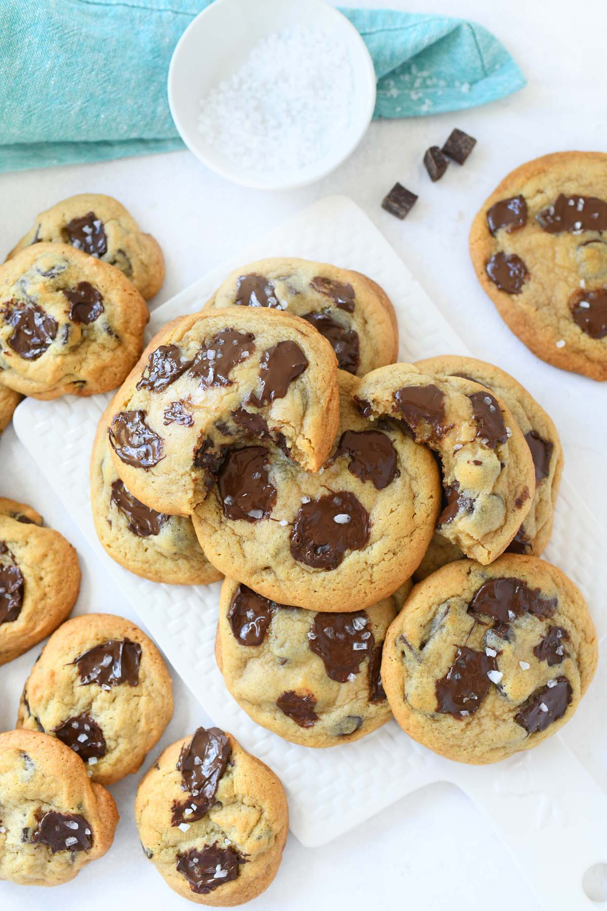 Chocolate chunks cookies with sea salt with a bite taken out of it.