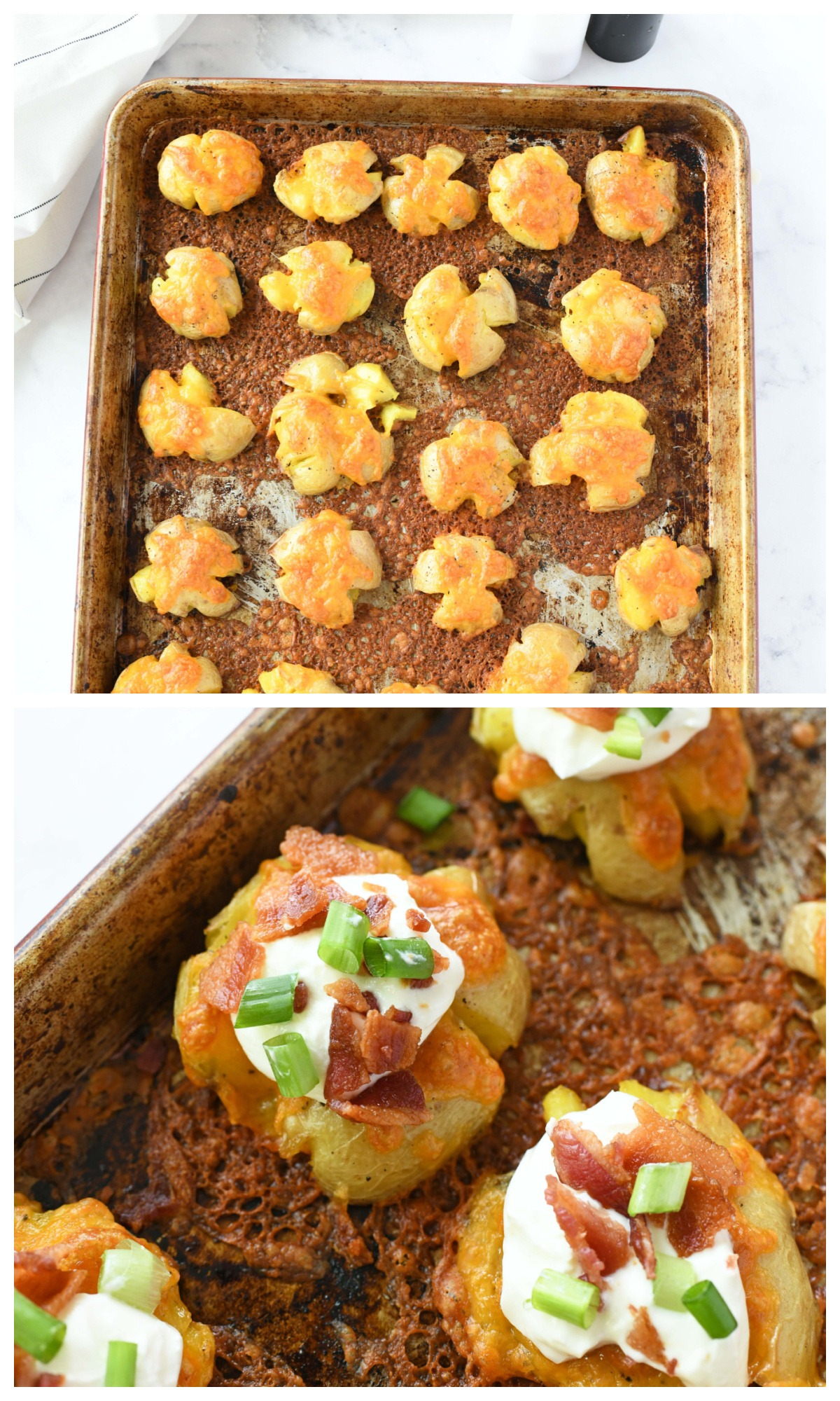 Loaded Smashed baby potatoes on a baking sheet with toppings.