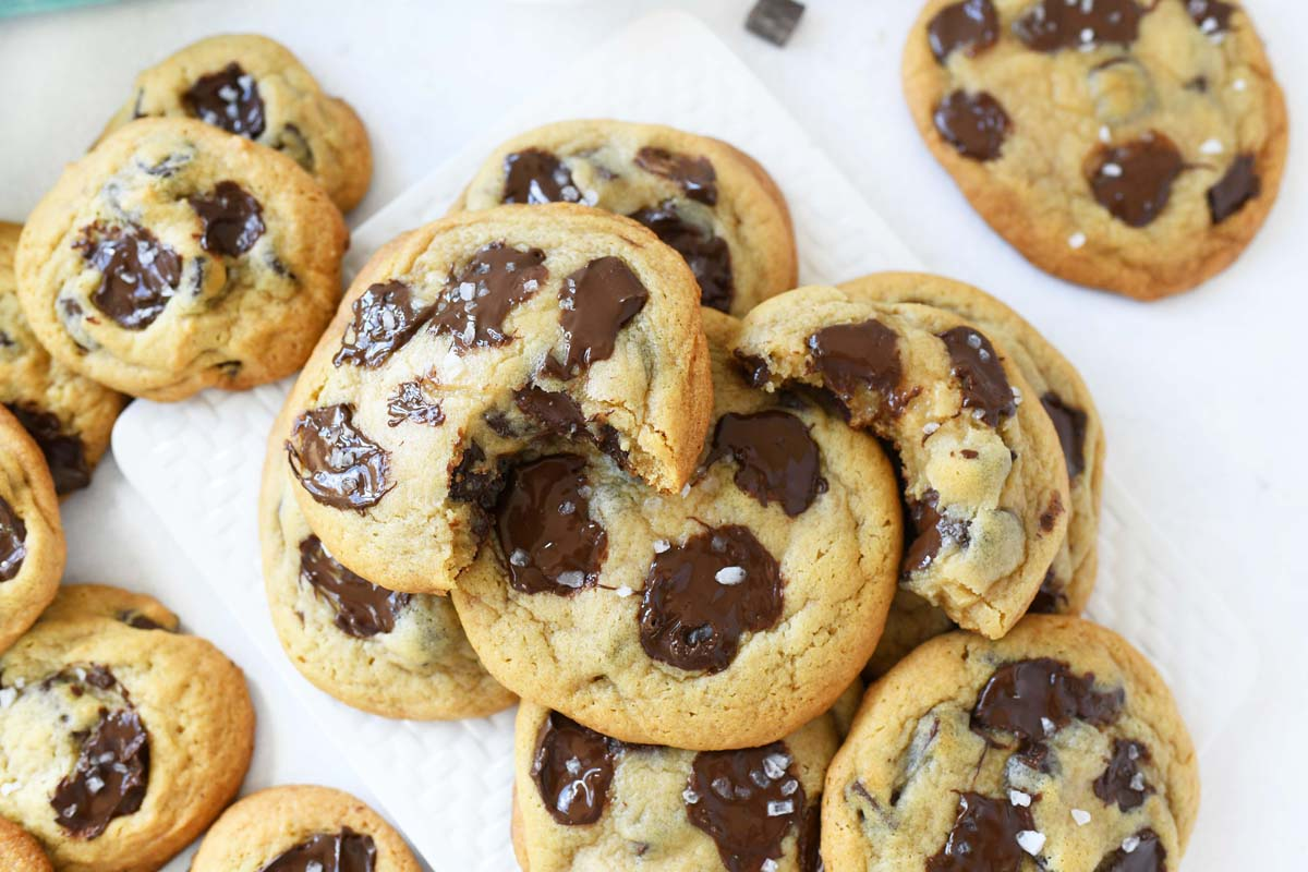 Salted chocolate chunk cookies on a white table.