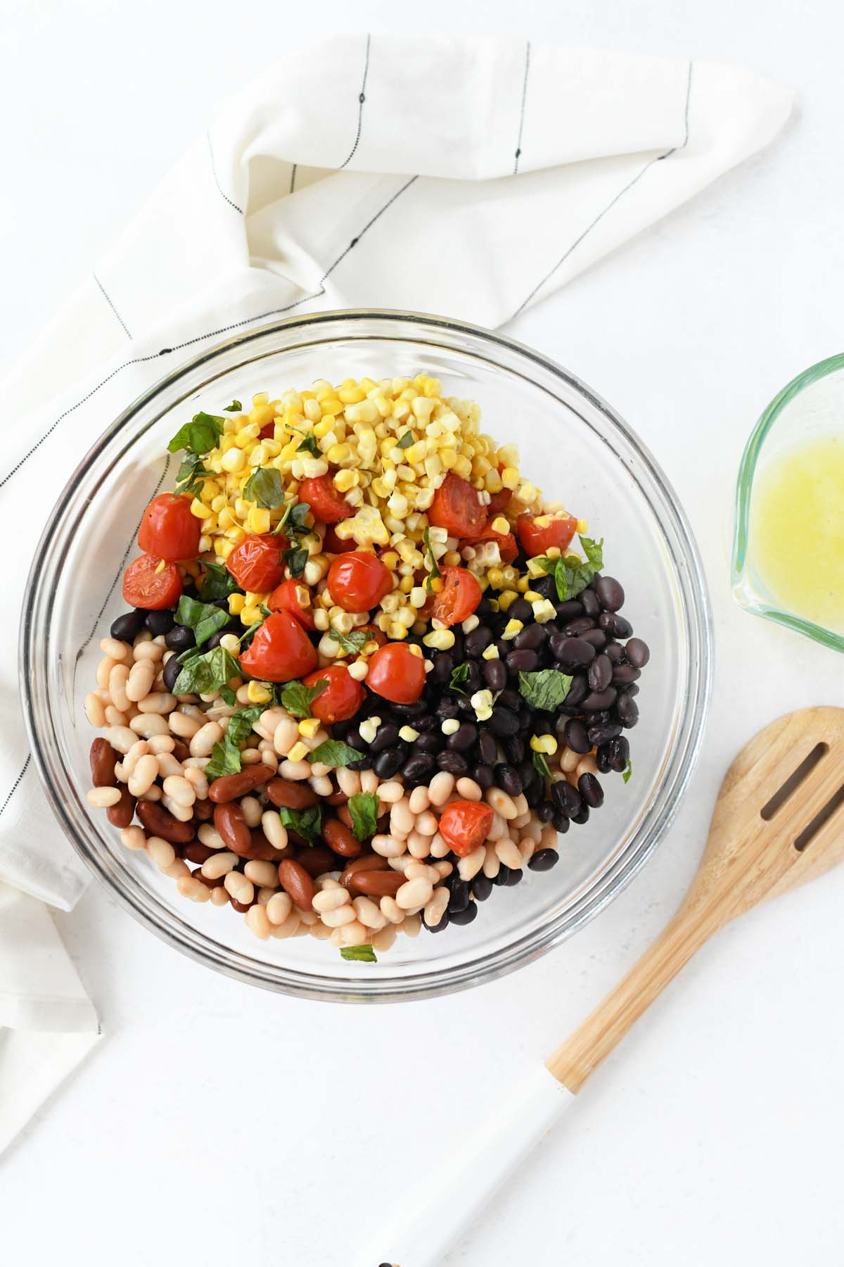 3 bean salad ingredients in a glass bowl.