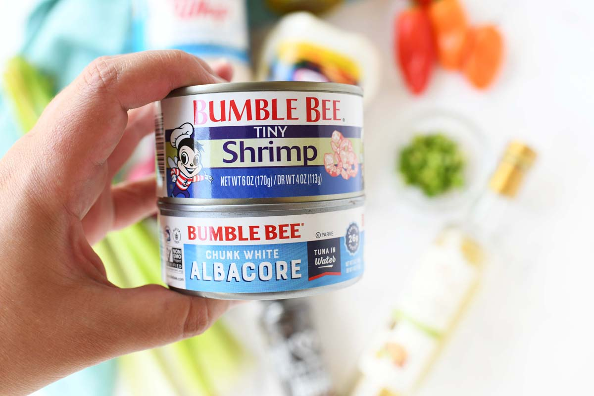 Bumblebee tiny shrimp and tuna can in a hand.