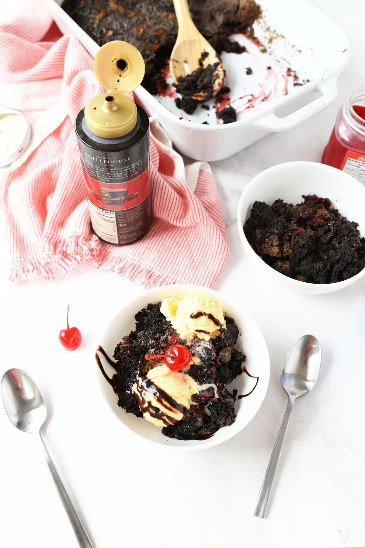 Chocolate cherry dump cake with ice cream and fudge.