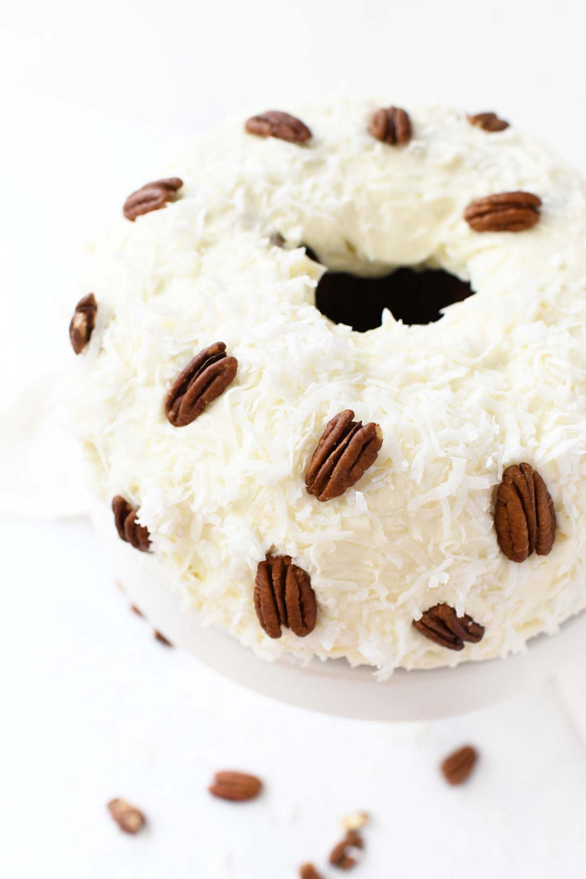 A fluffy Hummingbird Cake with coconut and pecans.