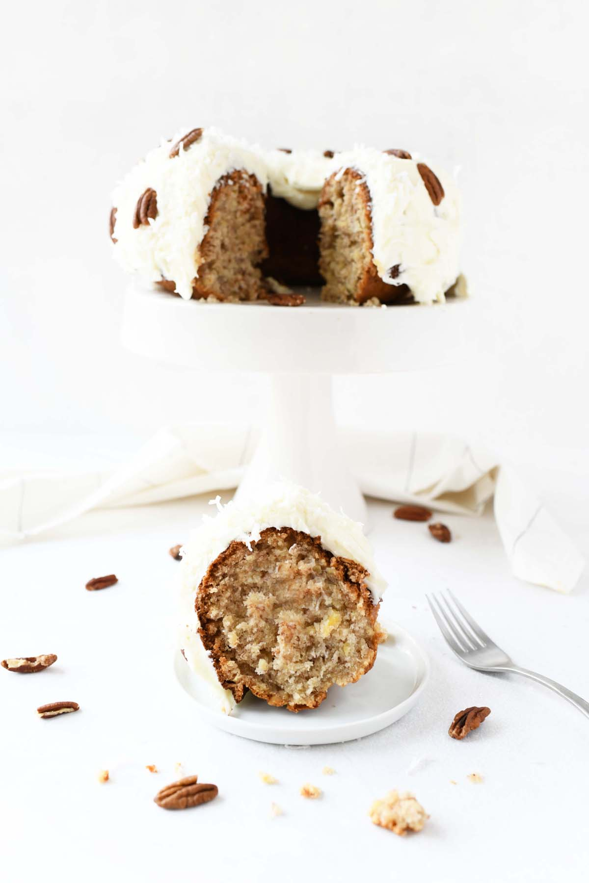 Hummingbird Cake on a white platter with a fork.