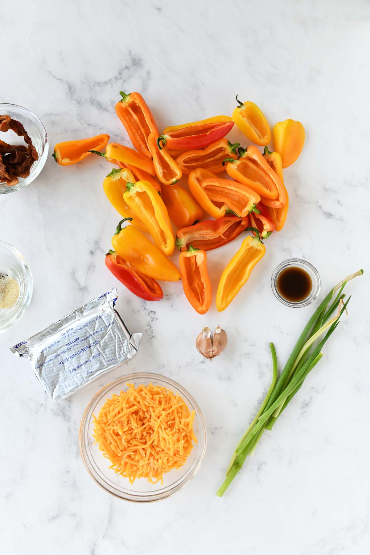 Sweet pepper popper ingredients on a white table.