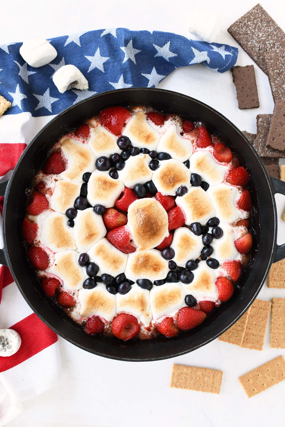 S'mores Berry Skillet Dip with a patriotic napkin.