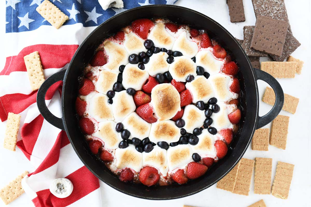 Smores Berry Skillet Dip in a cast-iron pan.