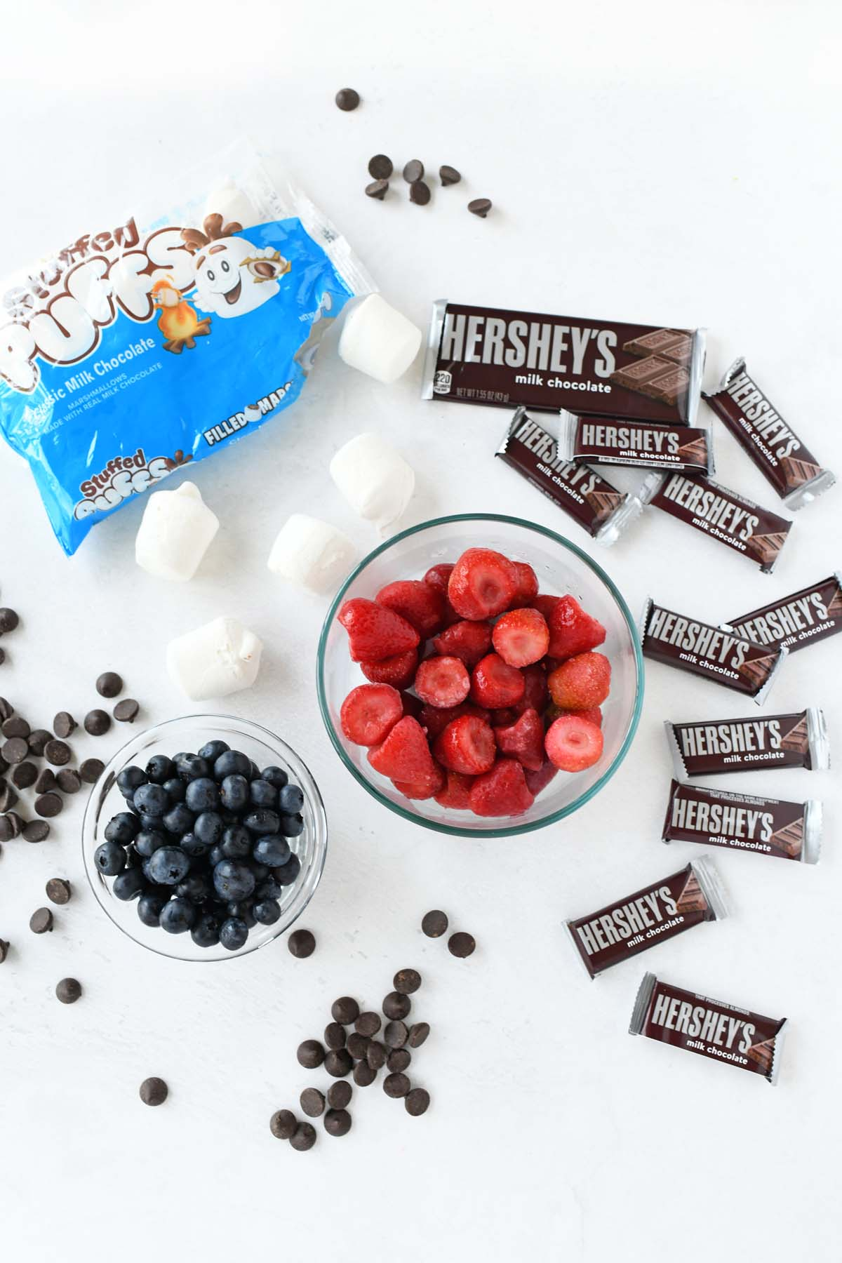 S'mores berry skillet dip ingredients on a white table.