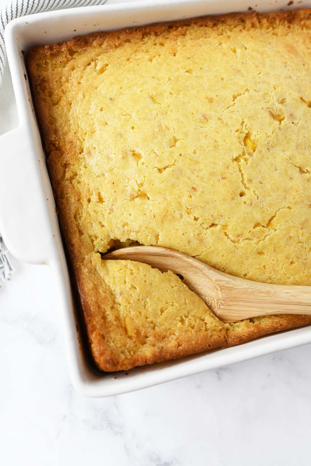 A spoon in corn casserole.