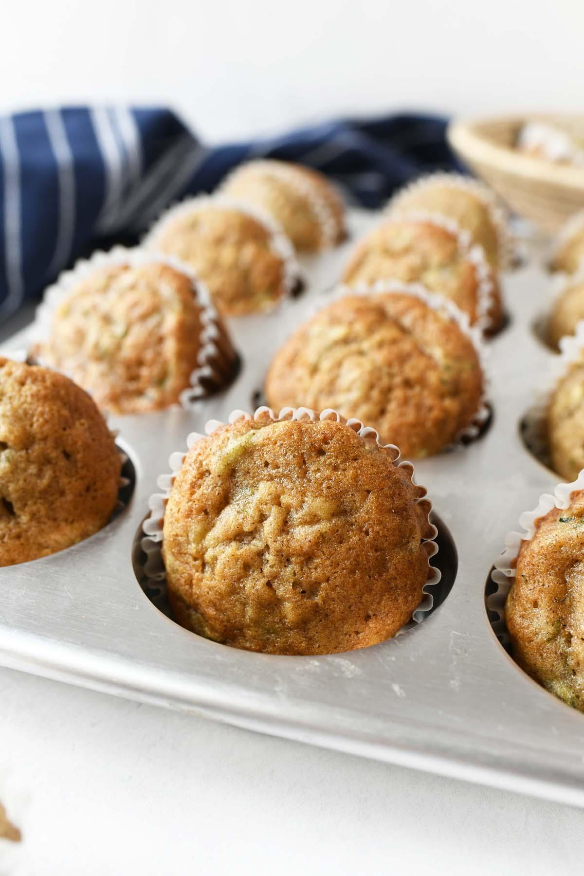 Banana Zucchini muffins in a silver muffin pan.