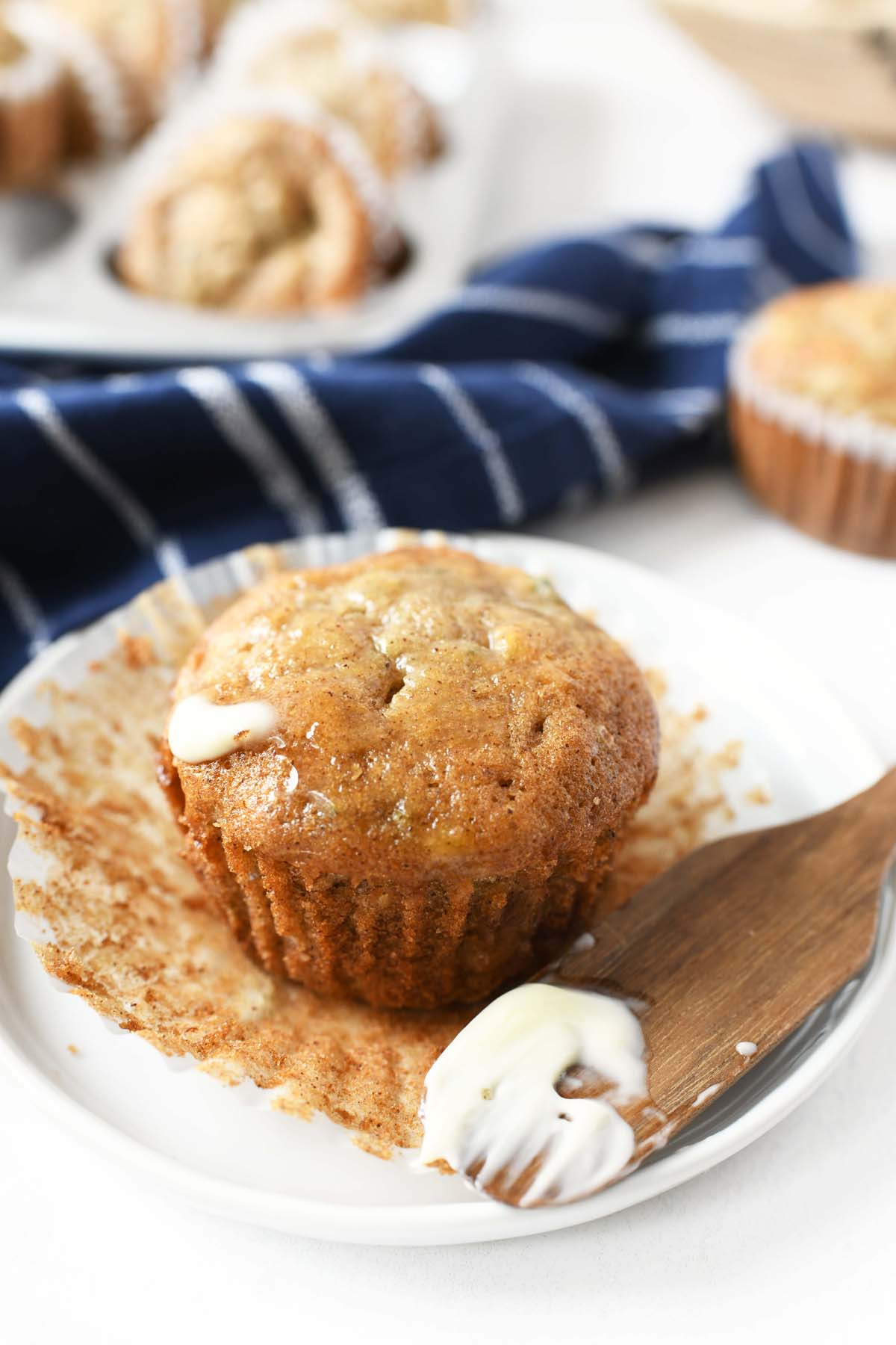 Zucchini banana muffin with melted butter on it.