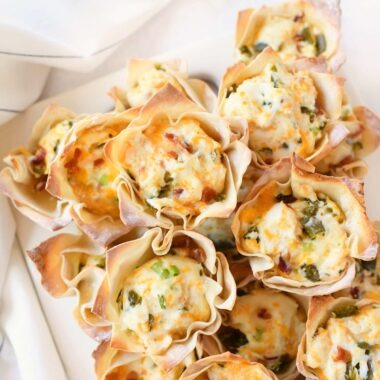 Cheesy Bacon Pepper Cups on a white platter.