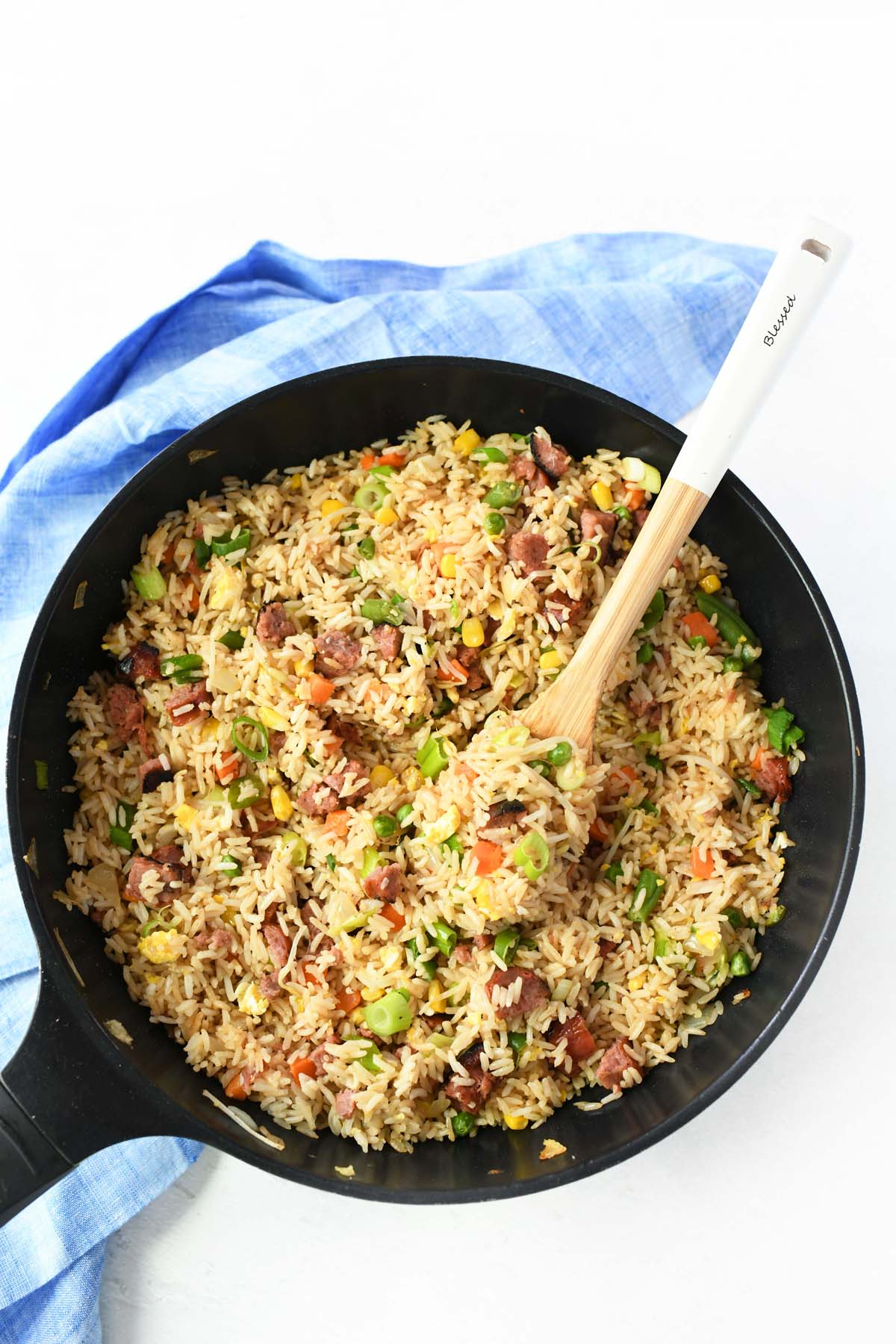 Chinese Fried rice with bean sprouts in a black wok.