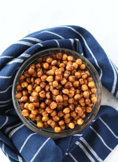Cinnamon and sugar air fried chickpeas near a blue napkin.