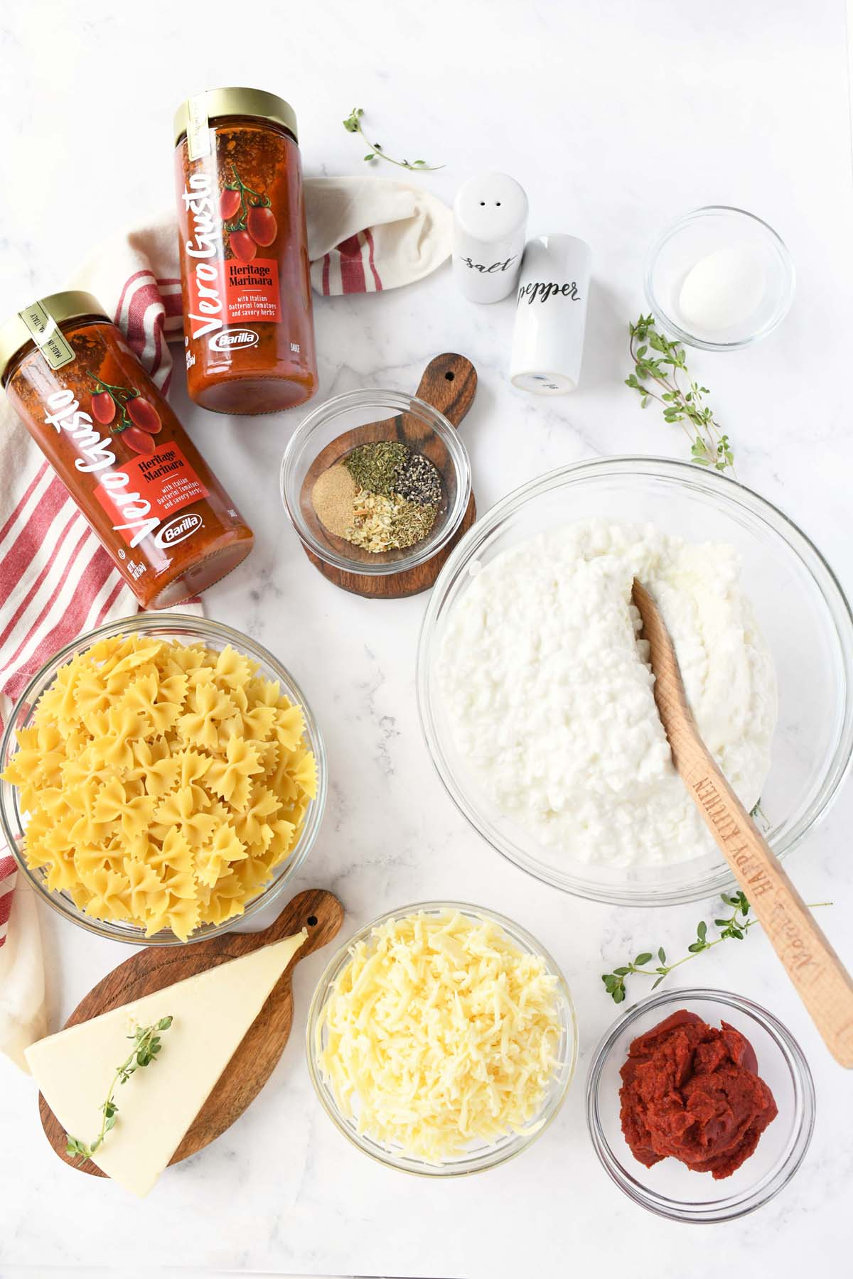 Four Cheese pasta ingredients on a white table.