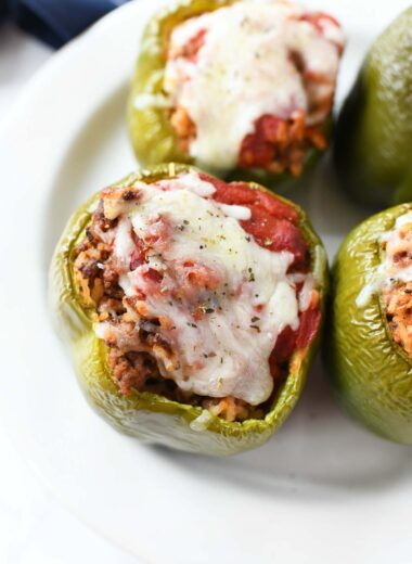 Green peppers with cheese on a white plate.