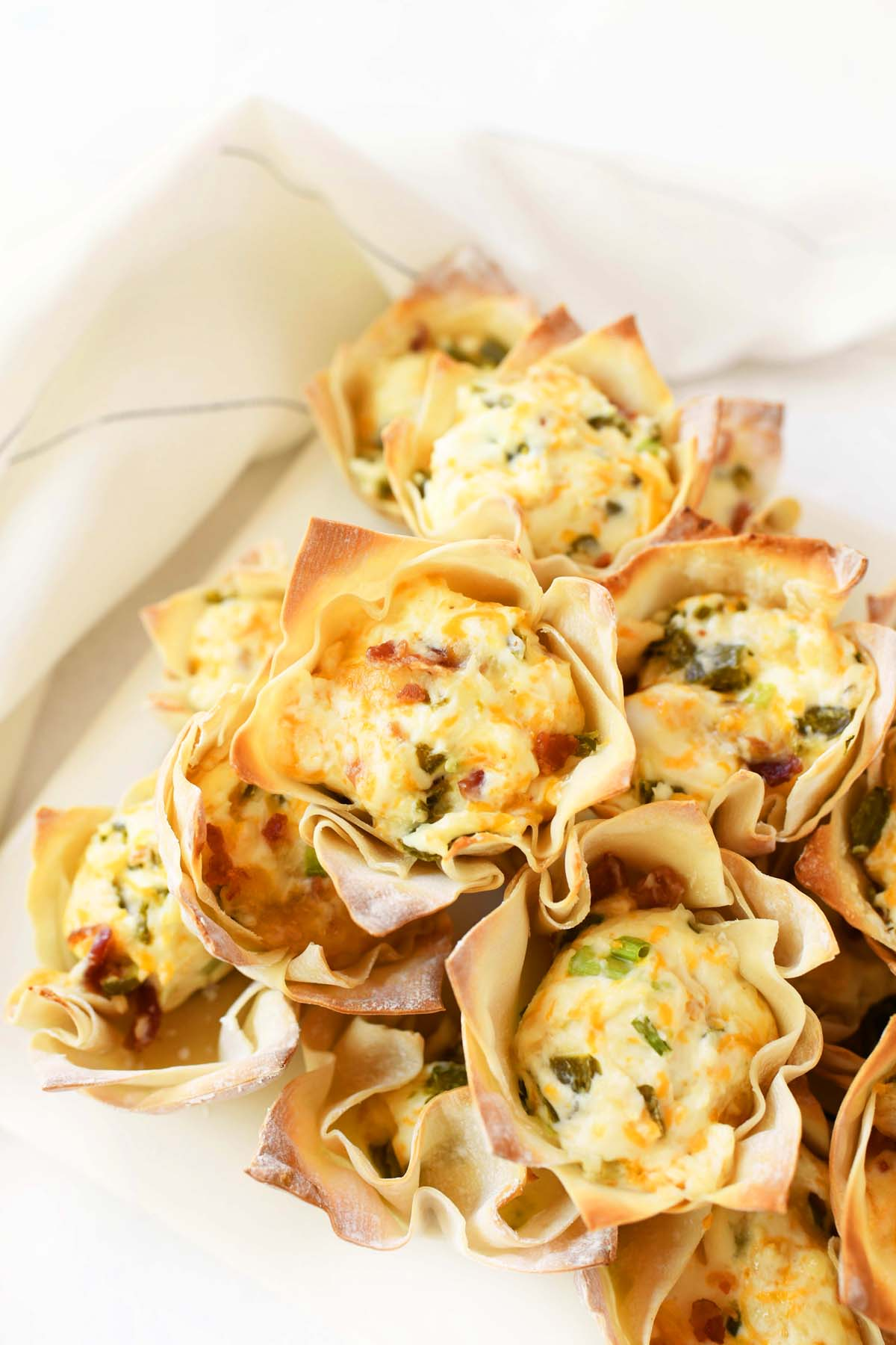 Jalapeno Popper Wontons Cups on a white tray.