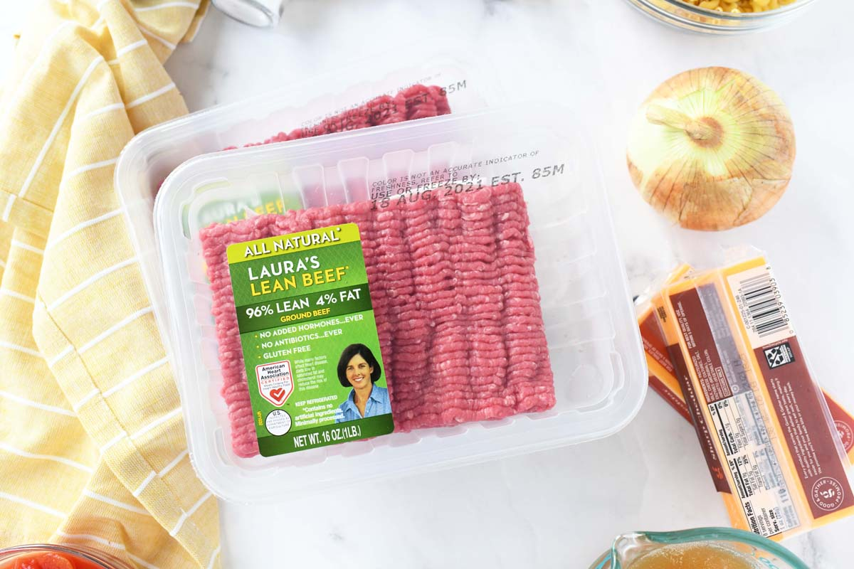 Laura's Lean beef package near ingredients and a yellow napkin.