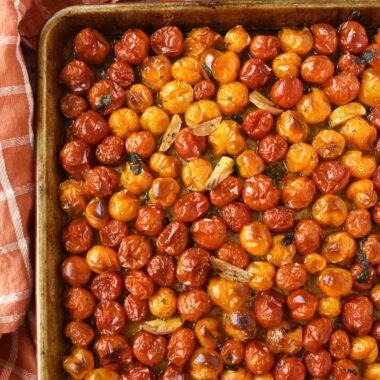 Oven roasted tomatoes on a baking sheet.