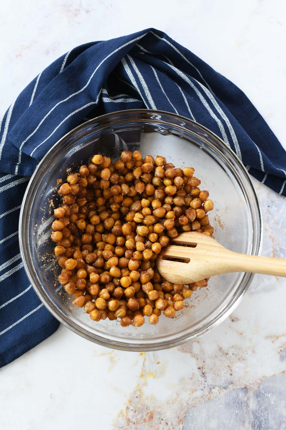 Cinnamon and Sugar chickpeas in a bowl with a spoon.