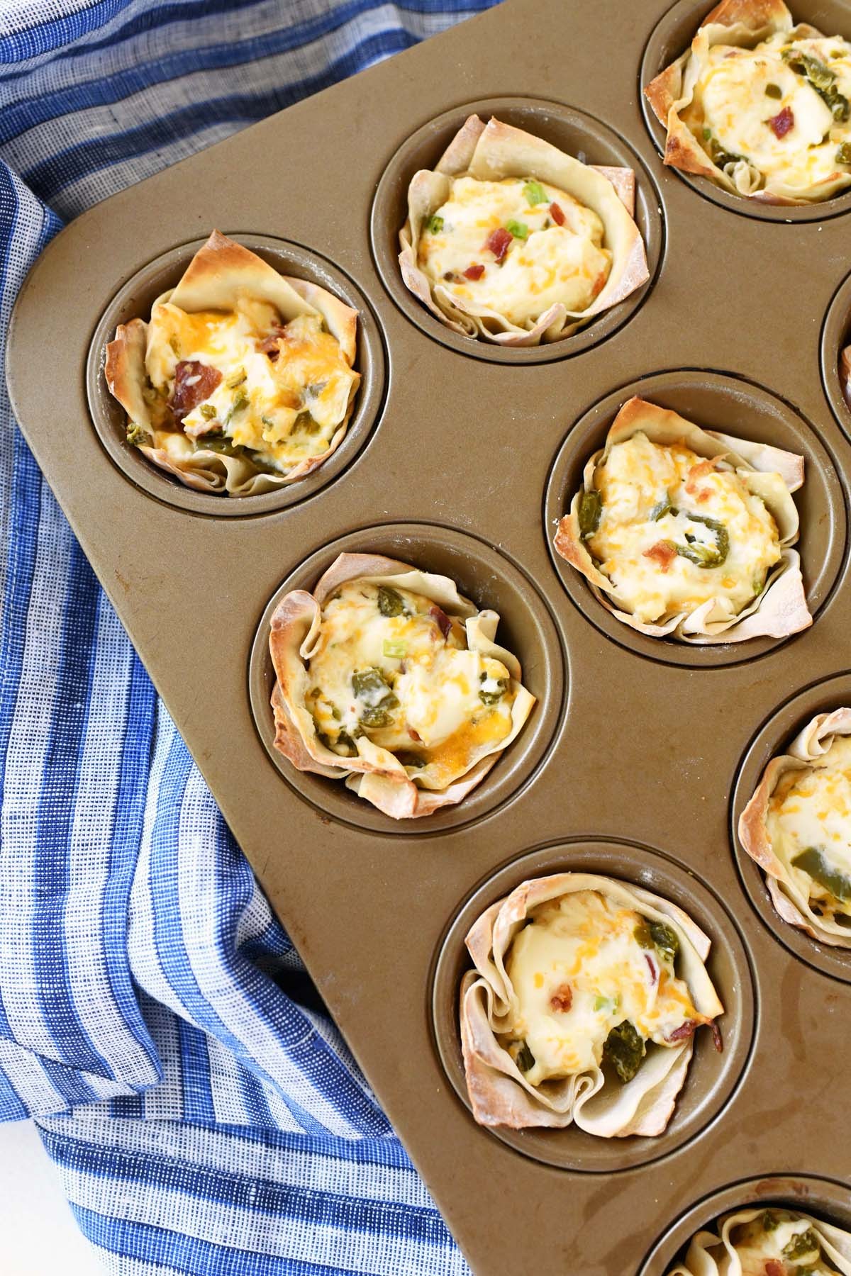baked jalapeno popper cups in a muffin tin.