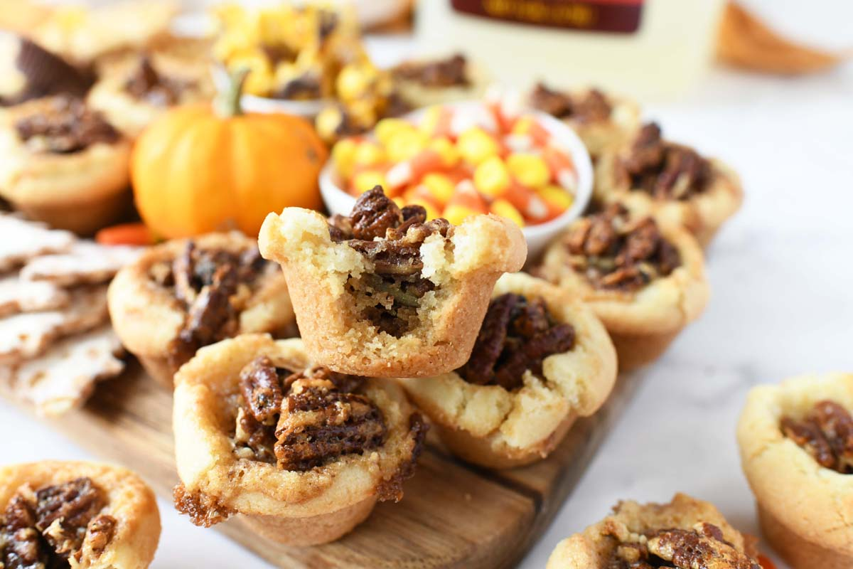 Pecan Pie Sugar Cookie Cups on a wooden board.