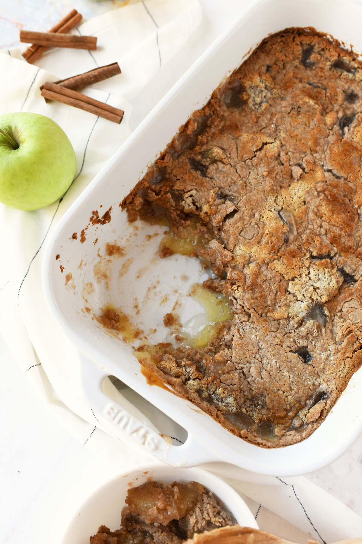 A white pan with apple spice dump cake.